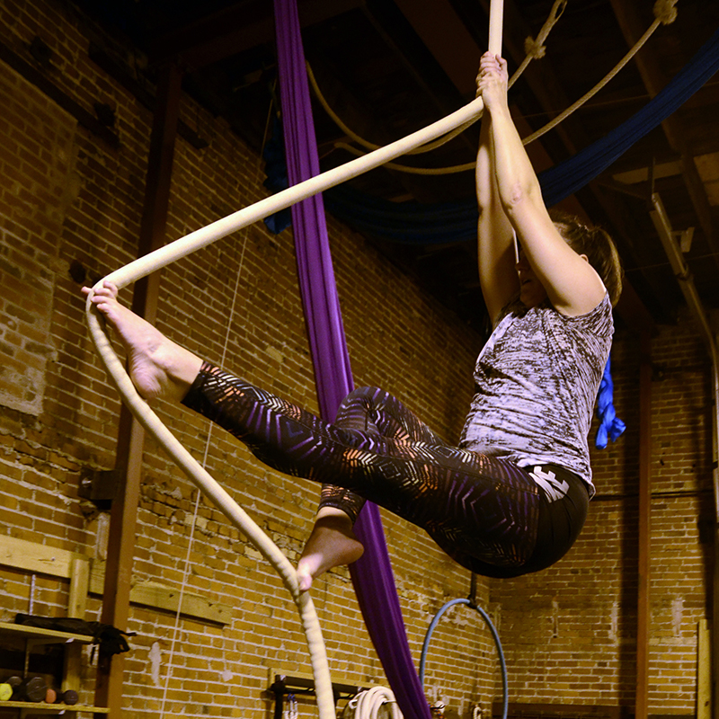 Brittany doing a toe climb on a rope