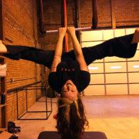 Alison straddle under trapeze