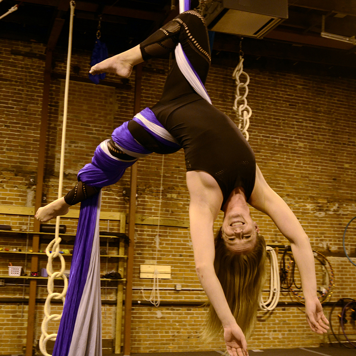 Claire on a silk doing a scorpion