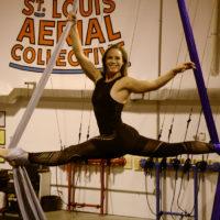 Claire doing a split on silks